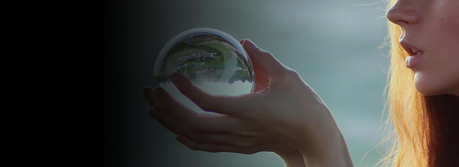Woman holding Crystal Ball